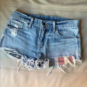 Frayed and distressed Ralph Lauren denim shorts